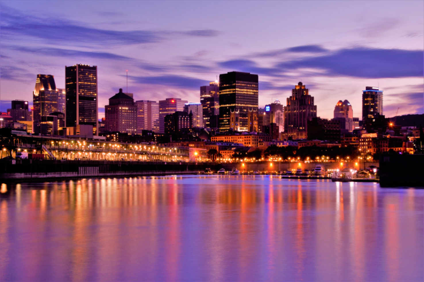 Large night tiime skyline across the water in montreal quebec canada